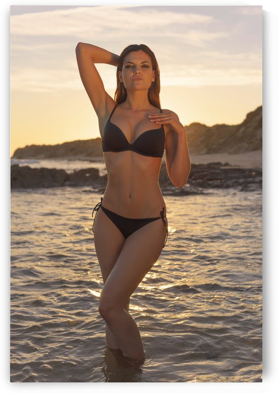 Woman in black bikini standing in the shallow water at the coast at sunset; Tarifa, Cadiz, Andalusia, Spain by PacificStock