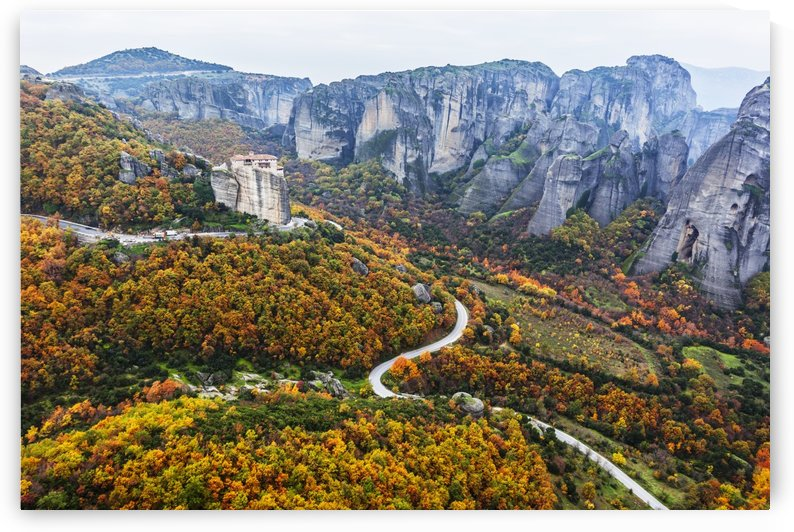 Monastery perched on a cliff with autumn coloured foliage; Meteora, Greece by PacificStock