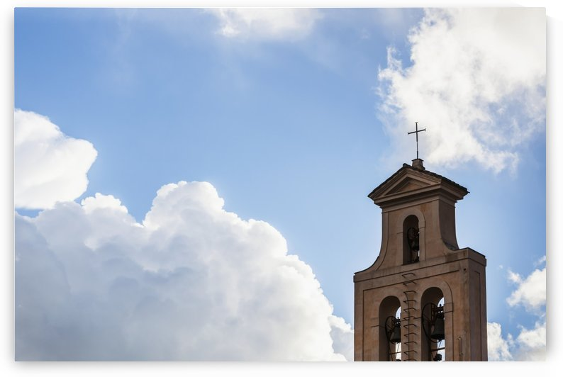 Cross and bell tower of a church against a blue sky with cloud; Rome, Italy by PacificStock