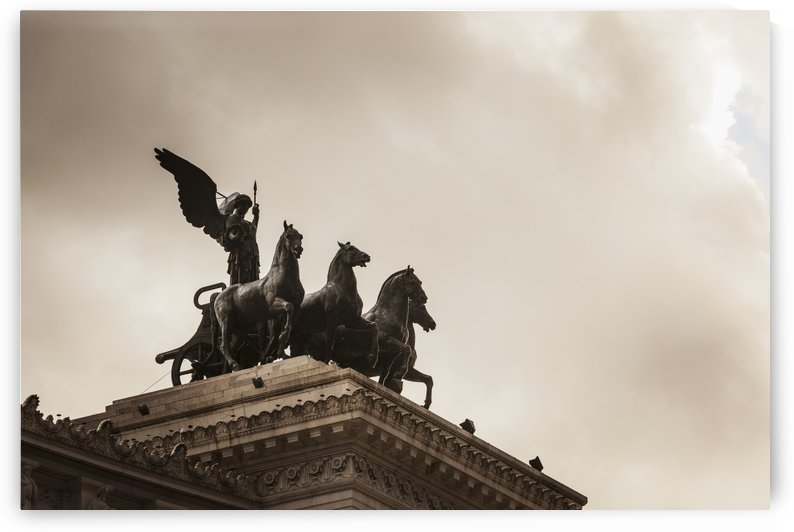 On either side of the roof-top viewing area was the goddess Victoria riding on quadrigas; Rome, Italy by PacificStock