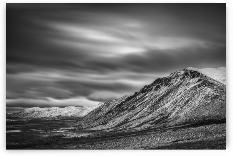 Black and white long exposure of clouds over the Cloudy Range along the Dempster Highway; Yukon, Canada by PacificStock
