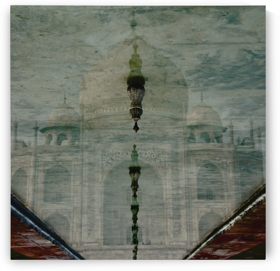 Upside-down reflection of Taj Mahal in a pool of water; Agra, Uttar Pradesh, India by PacificStock