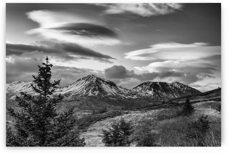 Black and white photo of lenticular clouds over the Three Sisters mountains, Kodiak Island, Southwest Alaska by PacificStock