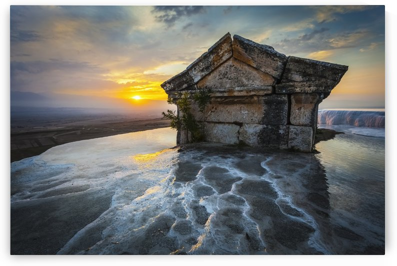 Tomb submerged in a travertine pool in Hierapolis at sunset; Pamukkale, Turkey by PacificStock