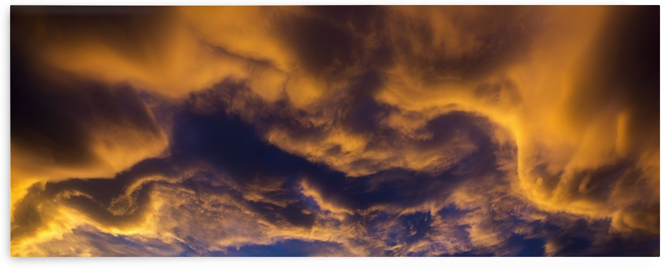 Dramatic colourful clouds at sunset with interesting formations and some blue sky; Calgary, Alberta, Canada by PacificStock