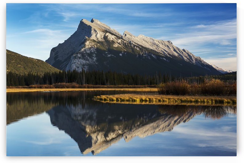 Mountain lake reflecting mountain at sunset with blue sky and clouds, Banff National Park; Alberta, Canada by PacificStock