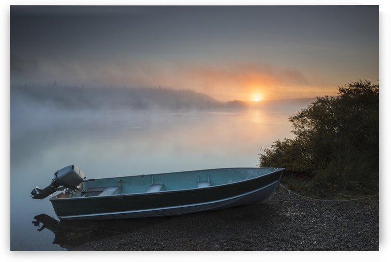 The sun rises through fog over the Kvichak River in autumn with a skiff in the foreground, Bristol Bay Region, Southwest Alaska. by PacificStock