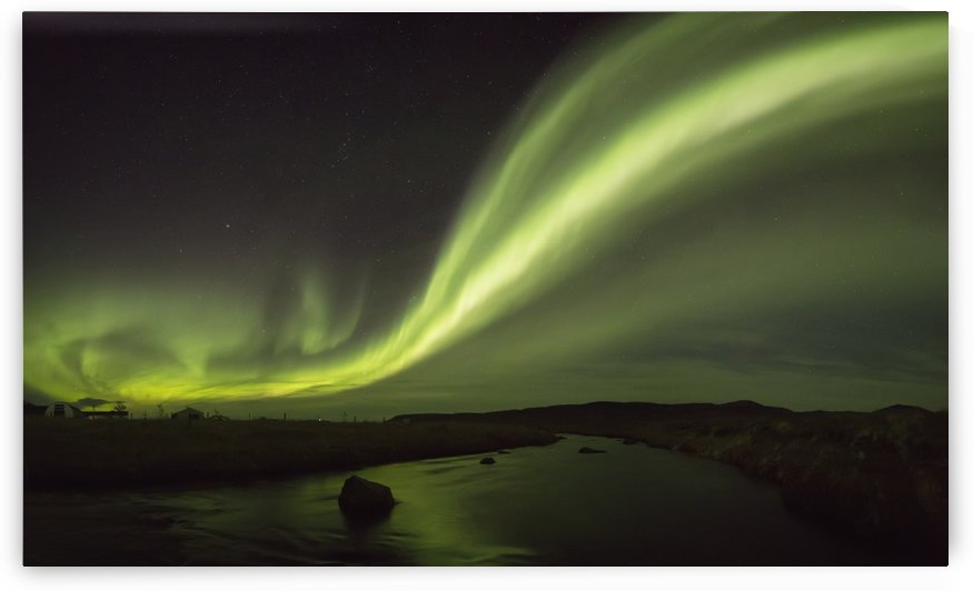 Northern lights over a river and farm in Northeast Iceland; Iceland by PacificStock