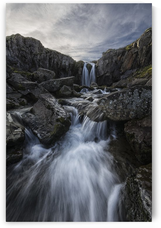 Stream flows over a waterfall along the eastern coast of Iceland; Iceland by PacificStock