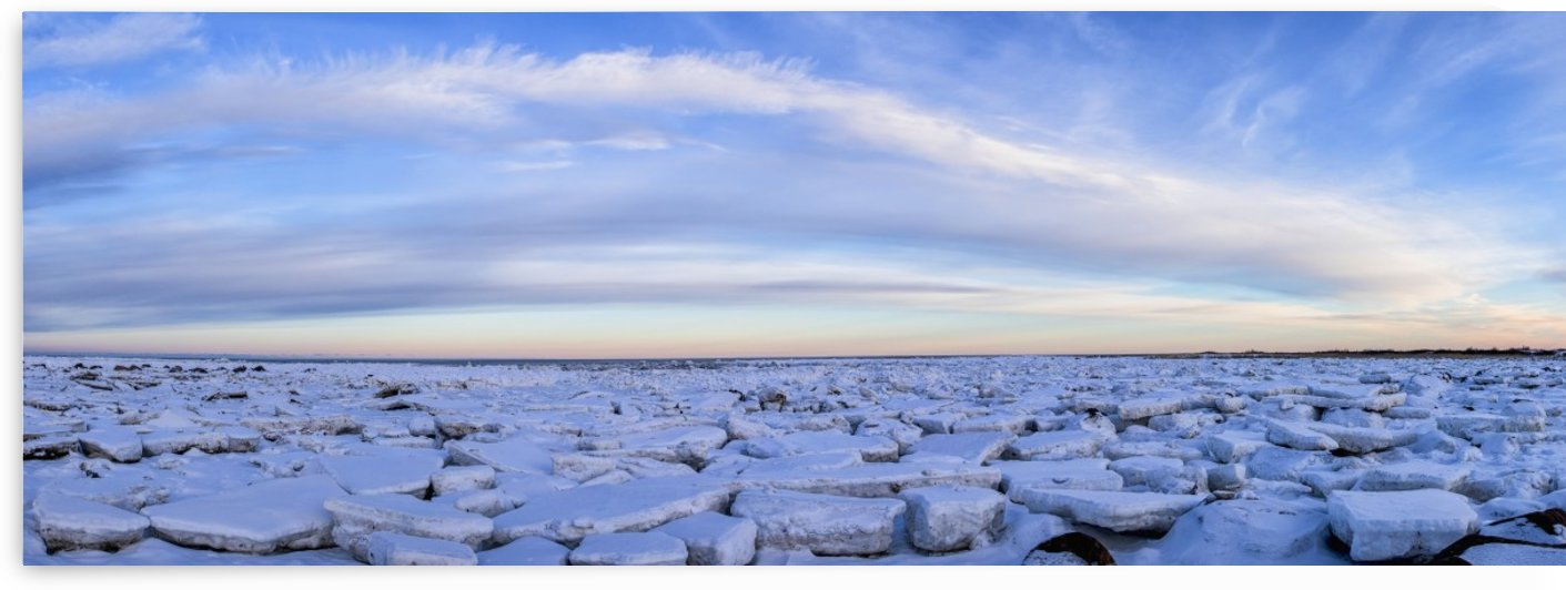 Ice forms on the shores of Hudson Bay as sunset starts to light up the clouds; Churchill, Manitoba, Canada by PacificStock