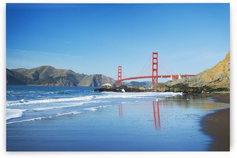 The Golden Gate Bridge in San Francisco with beautiful blue ocean in background by PacificStock