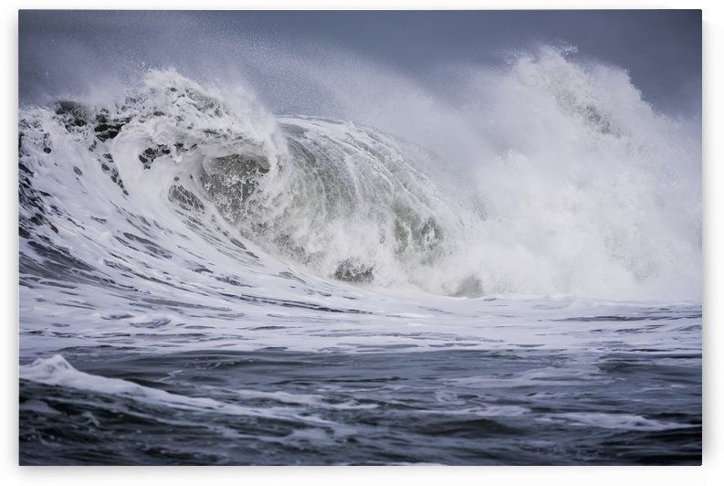 A large wave breaks on a stormy morning; Seaside, Oregon, United States of America by PacificStock