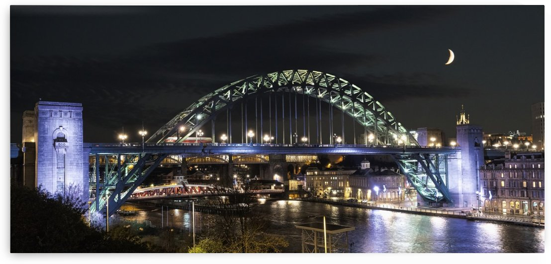 Tyne Bridge illuminated at nighttime over River Tyne with a crescent moon in the sky; Newcastle, Tyne and Wear, England by PacificStock