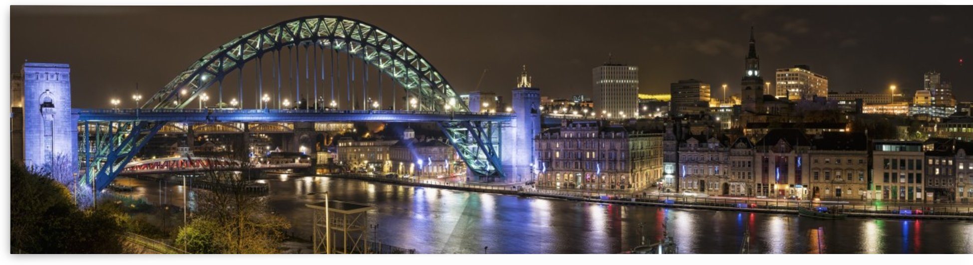Illuminated Tyne bridge over the River Tyne at nighttime; Newcastle, Tyne and Wear, England by PacificStock