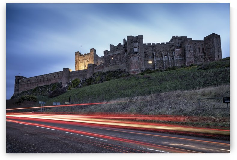 Light trails on the road and Bamburgh Castle; Bamburgh, Northumberland, England by PacificStock
