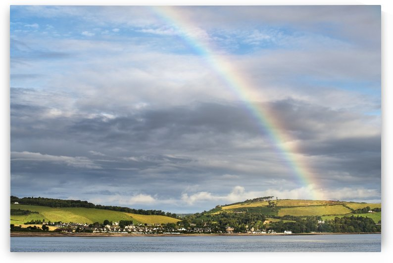 Rainbow in the sky over Chanonry Point; Moray Firth, Scotland by PacificStock