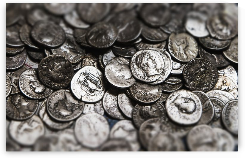 Roman coins in a pile; South Shields, Tyne and Wear, England by PacificStock