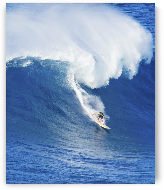Extreme surfer riding giant ocean wave in Hawaii by PacificStock