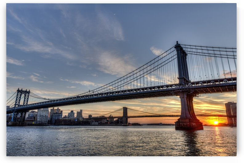 Sun setting behind Manhattan and Brooklyn Bridges; New York City, New York, United States of America by PacificStock