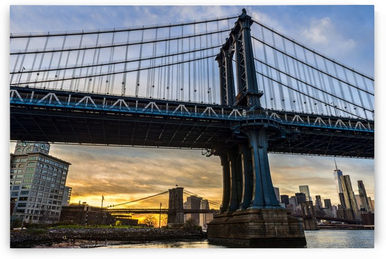 Manhattan and Brooklyn Bridges at sunset, Brooklyn Bridge Park; Brooklyn, New York, United States of America by PacificStock