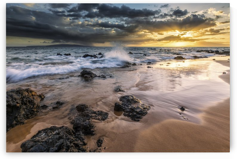 Water splashing on the beach with a golden sunset over the ocean; Hawaii, United States of America by PacificStock