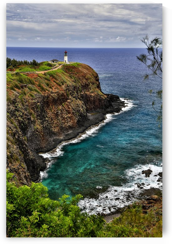 A lighthouse at the end of a trail above a cliff along the coast, Kilauea Point; Hawaii, United States of America by PacificStock