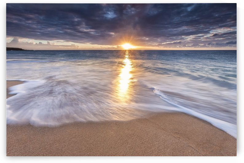 Sunlight reflected on the ocean to the sandy shore at sunset; Molokai, Hawaii, United States of America by PacificStock