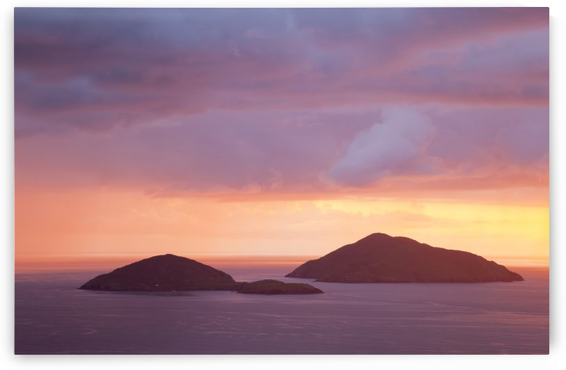 Small islands out in the ocean with a dramatic colourful sky at sunset; Caherdaniel, County Kerry, Ireland by PacificStock