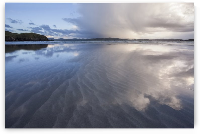 Stormy skies reflecting in the sand near the beach; Downings, County Donegal, Ireland by PacificStock
