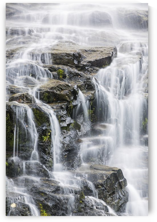 Detail of water cascading down dark rock on Bridalveil Falls in Keystone Canyon, South-central Alaska; Valdez, Alaska, United States of America by PacificStock
