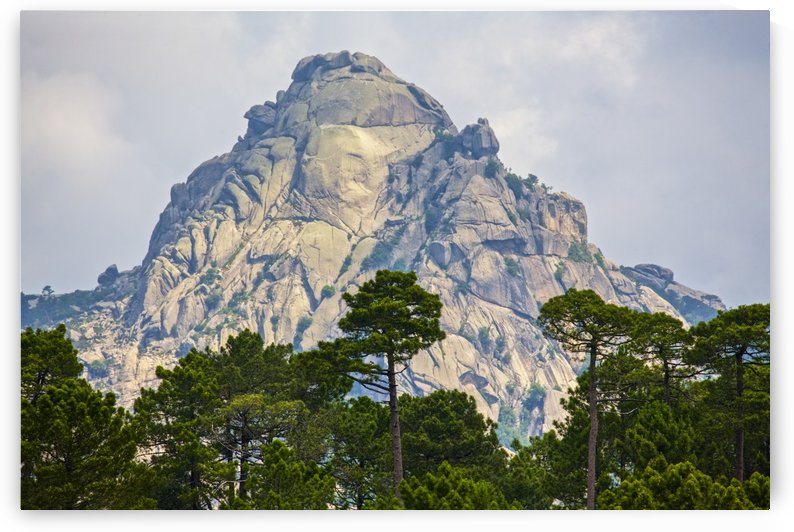 Dramatic mountain peak fringed by forest by PacificStock
