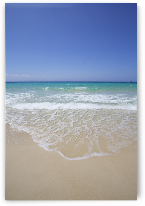 White sand island beach with crystal clear turquoise water and blue sky by PacificStock