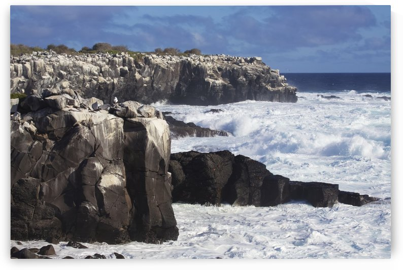 Dramatic cliffs,with rocky bay and crashing surf by PacificStock