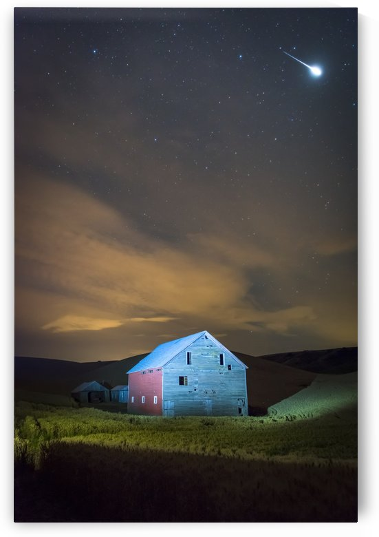 Stars and constellations above a farmhouse and barn in a wheat field at night; Palouse, Washington, United States of America by PacificStock