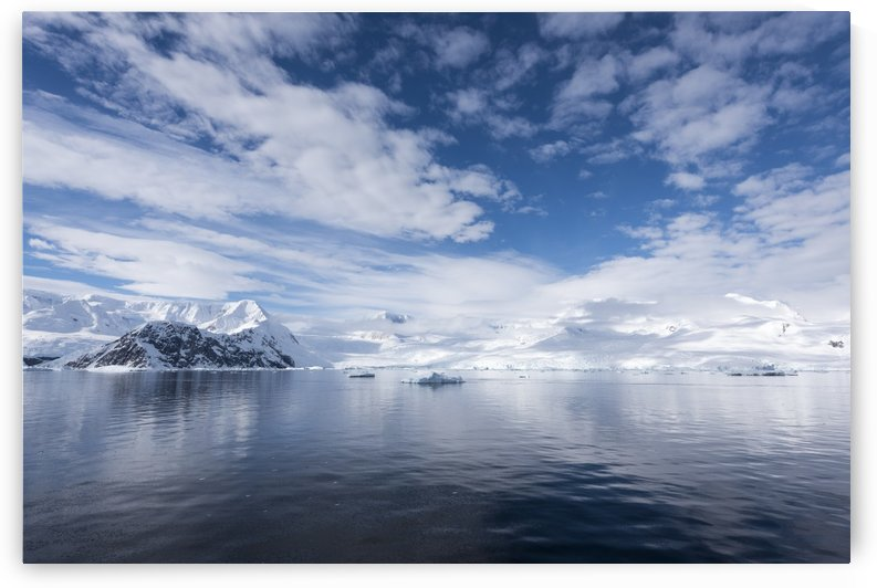 Sky reflected in water in Neko harbour; Antarctica by PacificStock