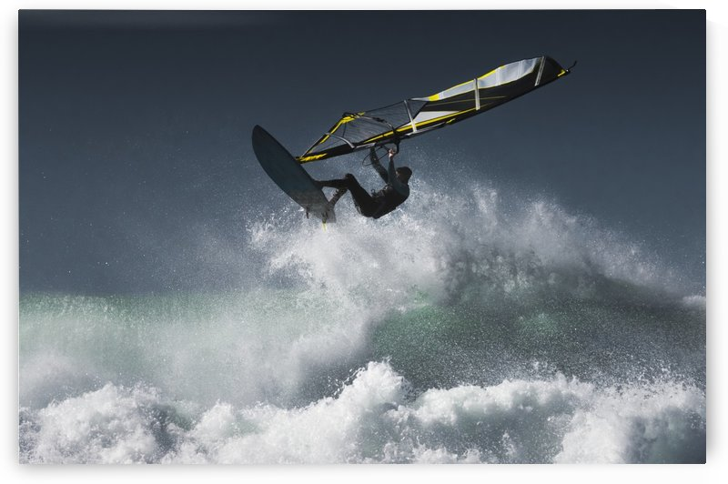 Windsurfer in the air above splashing waves; Tarifa, Cadiz, Andalusia, Spain by PacificStock