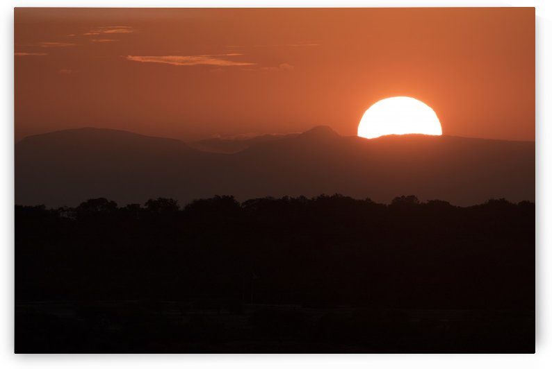 Setting sun overtop of the African landscape; South Africa by PacificStock