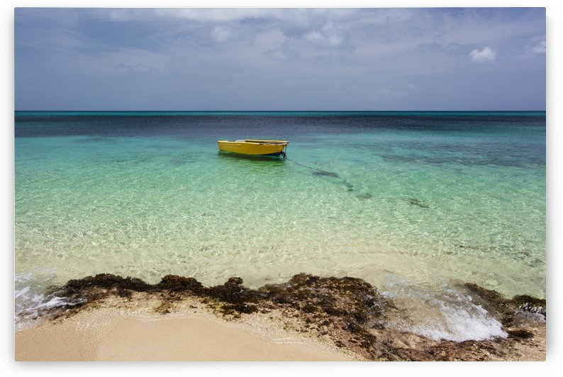 A lone boat in the turquoise water off a tropical island; Frederiksted, St. Croix, Virgin Islands, United States of America by PacificStock