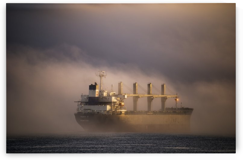 A ship anchors in the fog on the Columbia River; Astoria, Oregon, United States of America by PacificStock