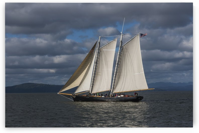 A large sailboat sails down the Columbia River; Astoria, Oregon, United States of America by PacificStock