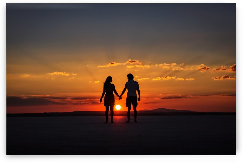 Couple holding by hands at sunset by MIRICA DAN-ALEXANDRU