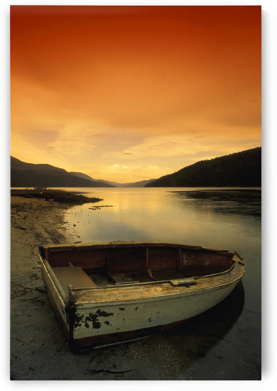 Old Rowboat At Water's Edge With Sunset Background by PacificStock