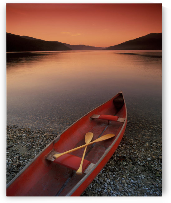 Canoe At Edge Of Mountain Lake, Shuswap, British Columbia, Canada by PacificStock