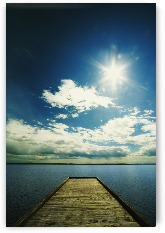 Bright Sun Over Dock On Lake by PacificStock