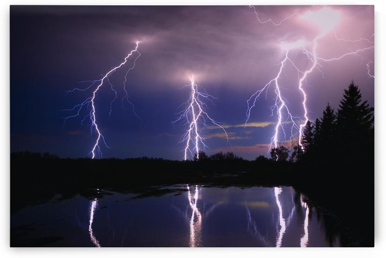Lightning Storm Over A Lake by PacificStock