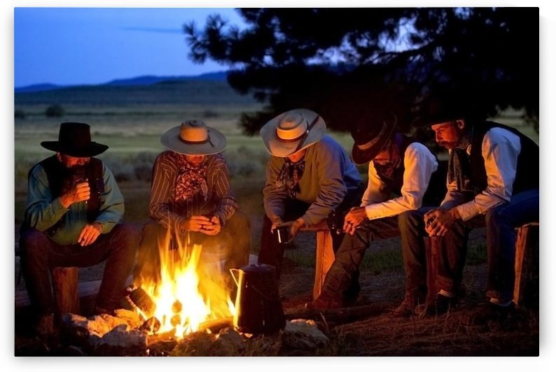 Group Of Cowboys Around A Campfire by PacificStock