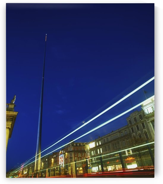 Spire Of Dublin, O'connell Street, Dublin, Ireland; Sculpture Against Traffic Light Streams by PacificStock