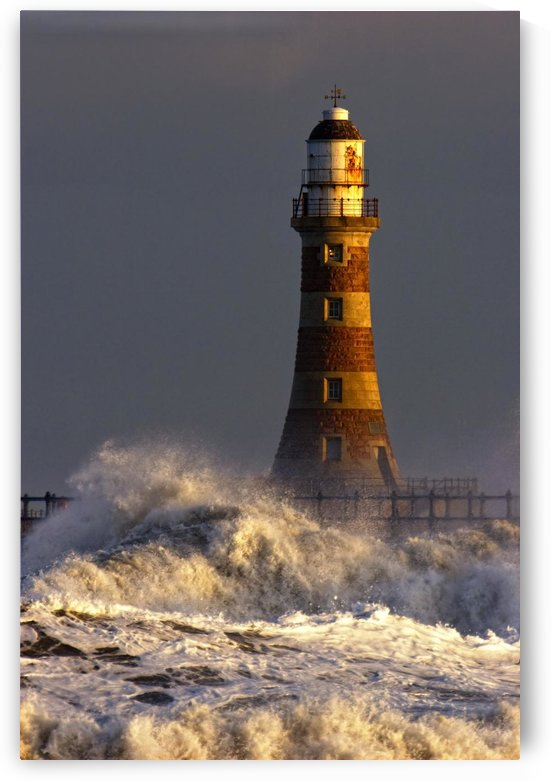 Waves Crashing Against A Lighthouse, Tyne And Wear, England by PacificStock