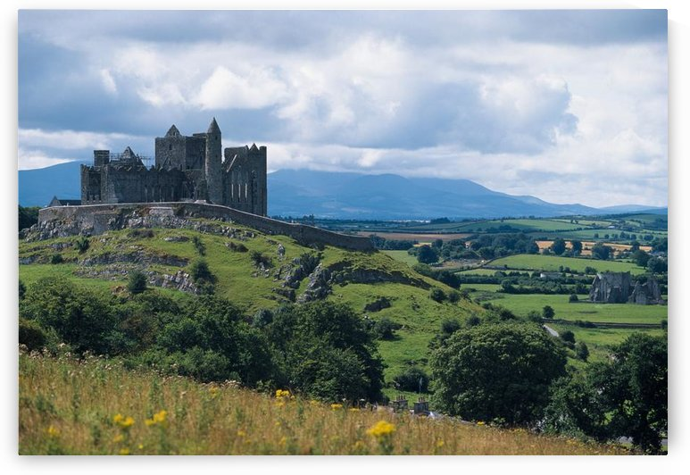 Rock Of Cashel, Co Tipperary, Ireland; Landscape With The Rock Of Cashel In The Distance by PacificStock