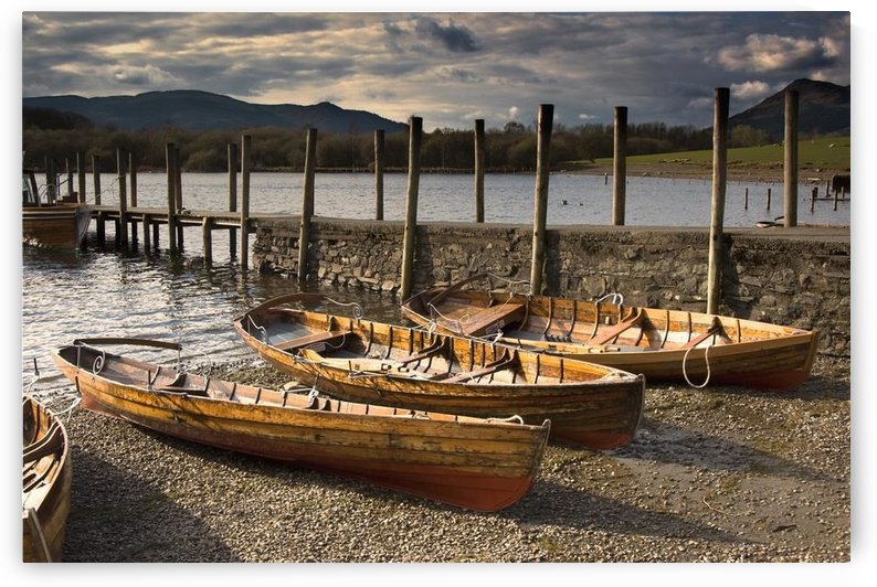 Lake District, Cumbria, England; Four Rowboats On Shore by PacificStock